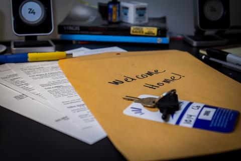 Move-in packet with keys and rental information.