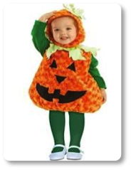 Toddler dressed in a pumpkin costume