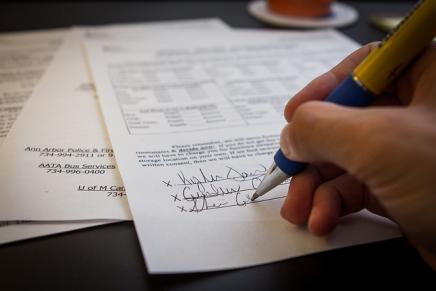 Person signing a lease.