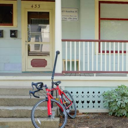 House with bike near steps